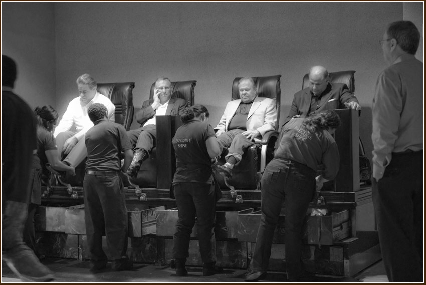 men having shoes shined