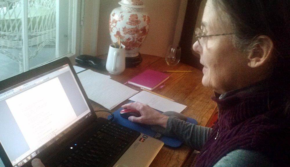 Juditha Dowd at desk