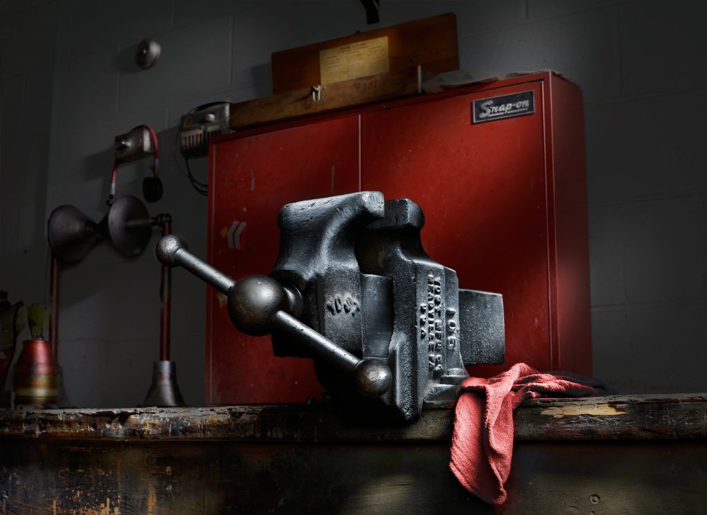 Bench vise in front of red toolbox