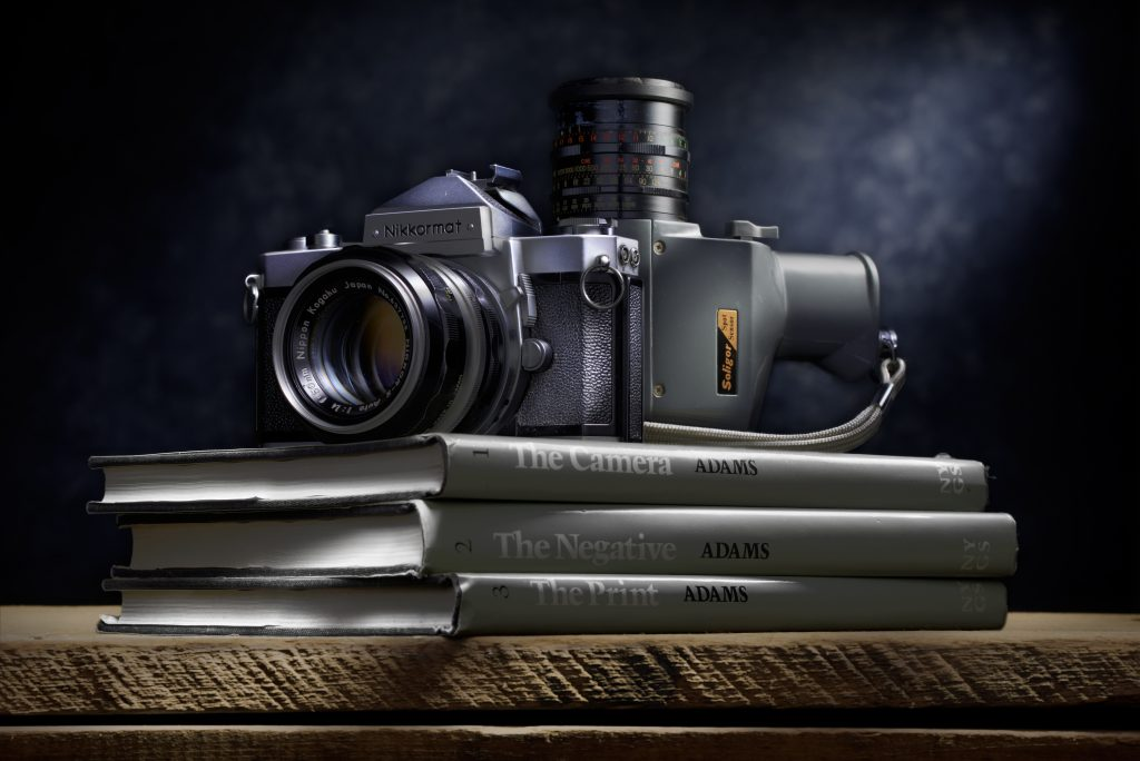 Camera on top of books by Ansel Adams