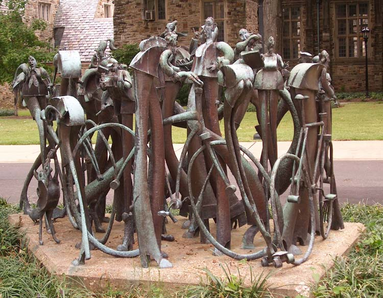 Copper sculpture of interacting people