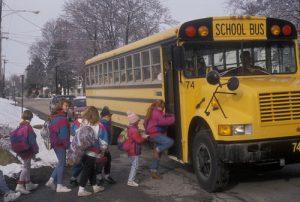 Kids boarding school bus