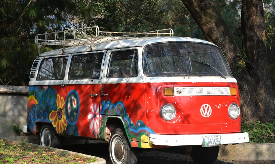 Red van with flowers painted on side