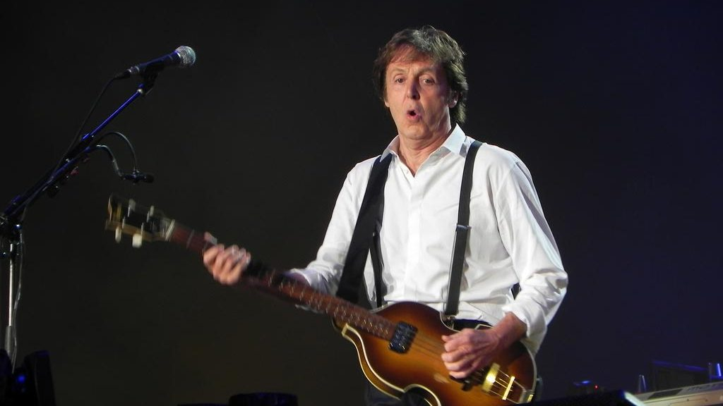 Paul McCartney playing at concert
