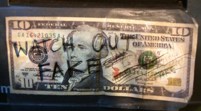 Watch Out Fake written on 10 dollar bill