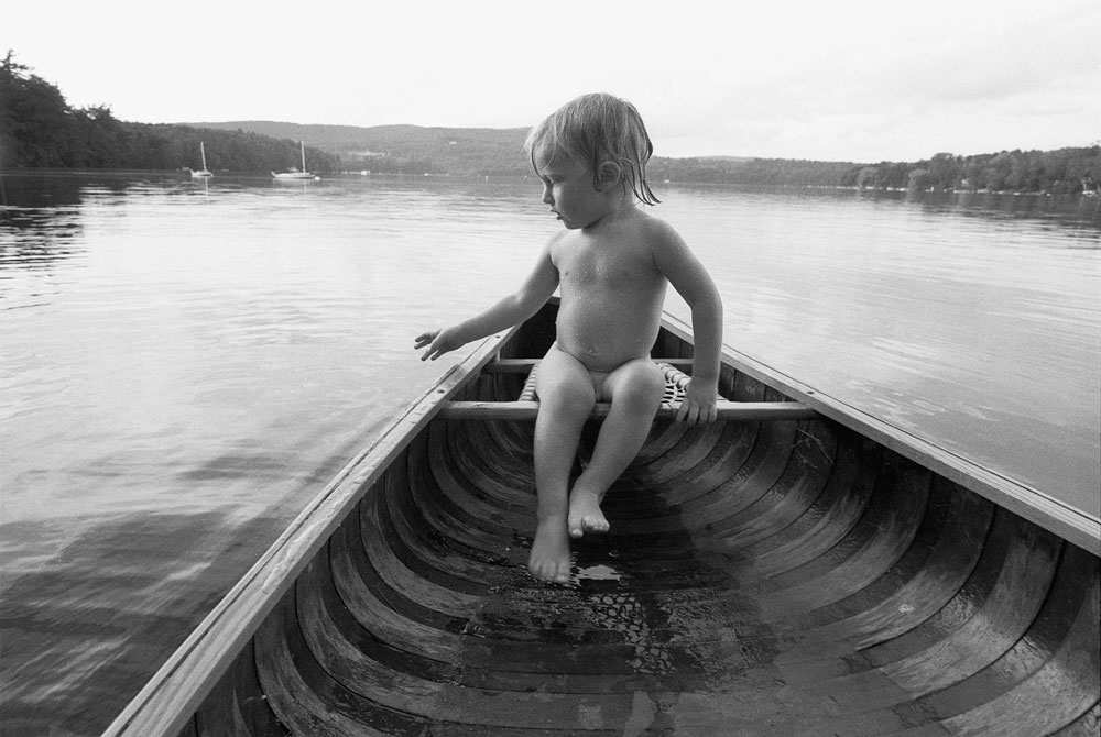 Emmet in a canoe on the lake