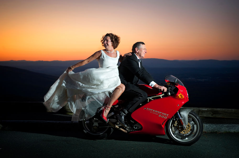 Jay and Louise in wedding clothes on motorcycle