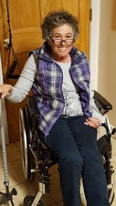 Meg Gutman in a wheelchair in her kitchen.