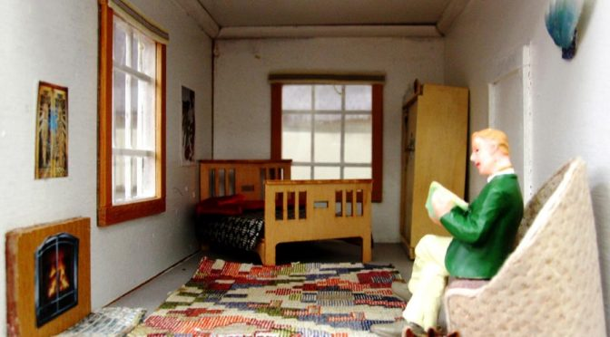 Dollhouse man in a dollhouse bedroom