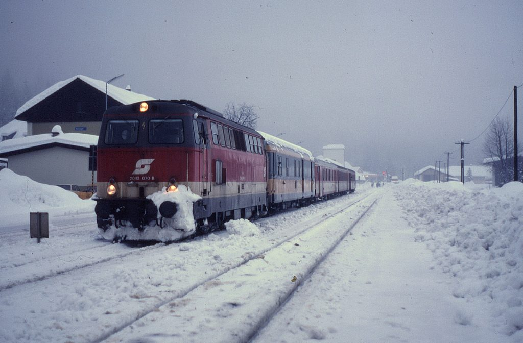 Train traveling through a snowy town