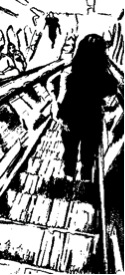 Figure riding down escalator
