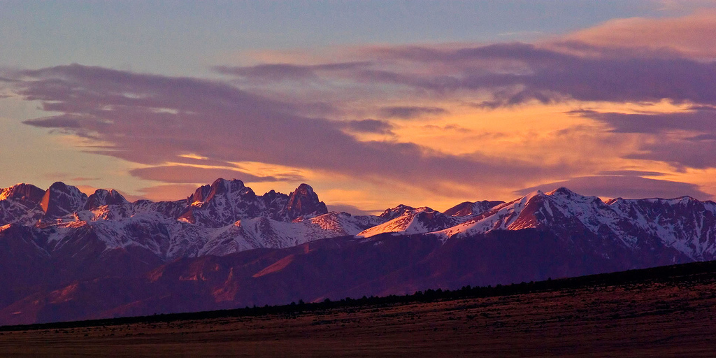 Sunset over snow-capped Rocky Mountains
