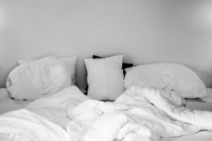 Unmade bed in black and white