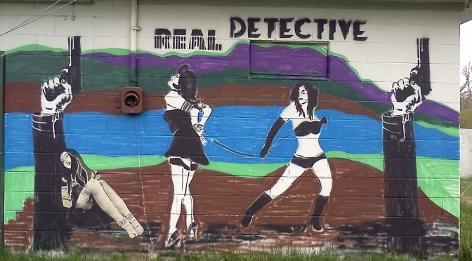 painting with words Real Detective on wall