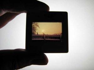Fingers holding a backlit slide