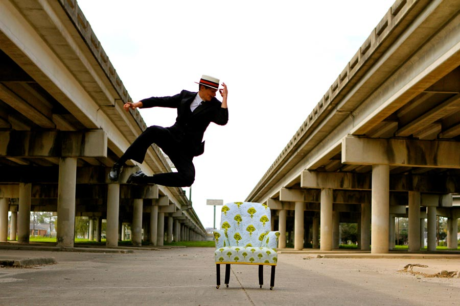 Heel Click, man jumping in air next to chair
