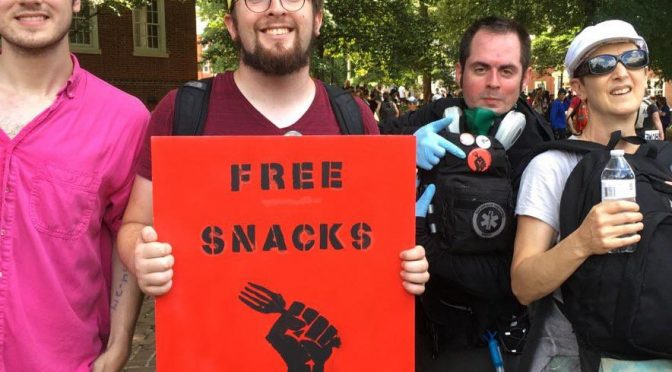 Snack squad holding food and their sign