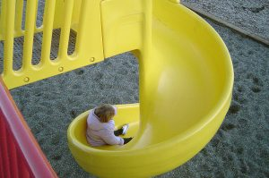 child on slide
