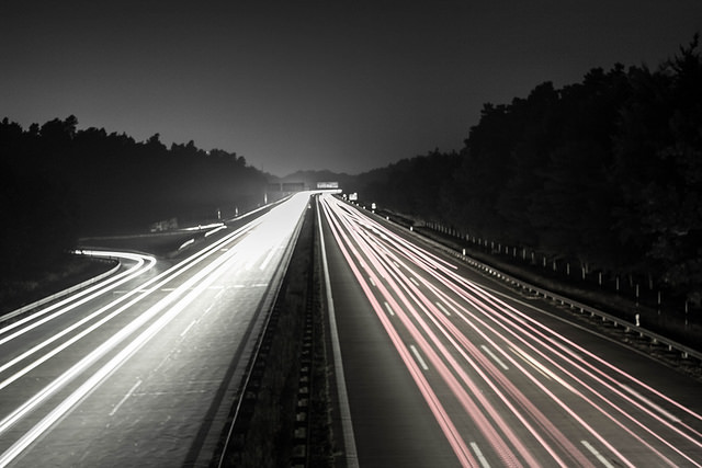 highway with streaming car lights