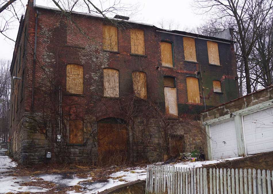 Boarded up brick building