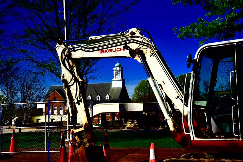 power shovel parked in front of church