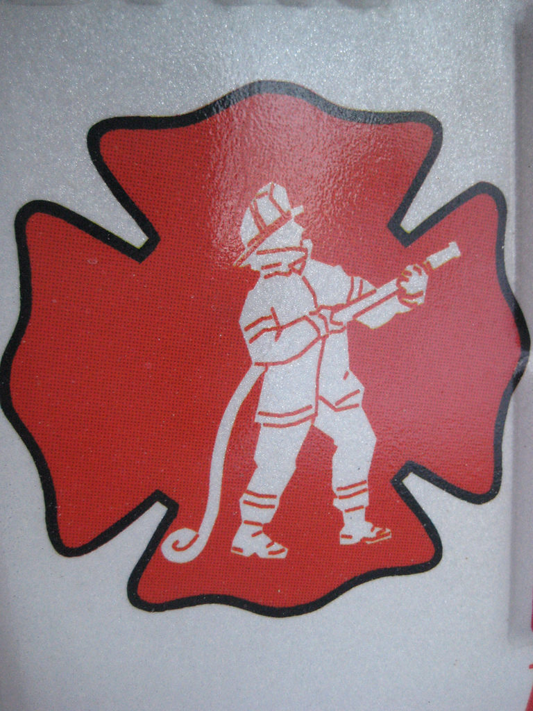 Emblem of fireman in red cross