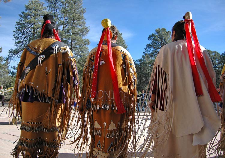 three Native Americans in ritual garb