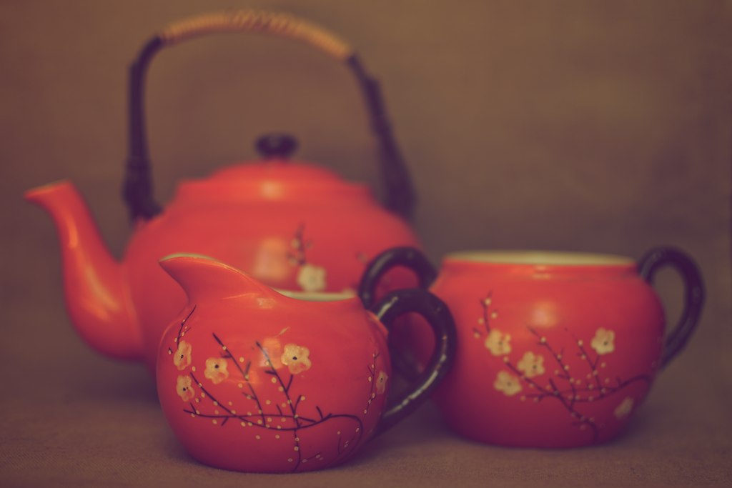 Orange and flowered teapot