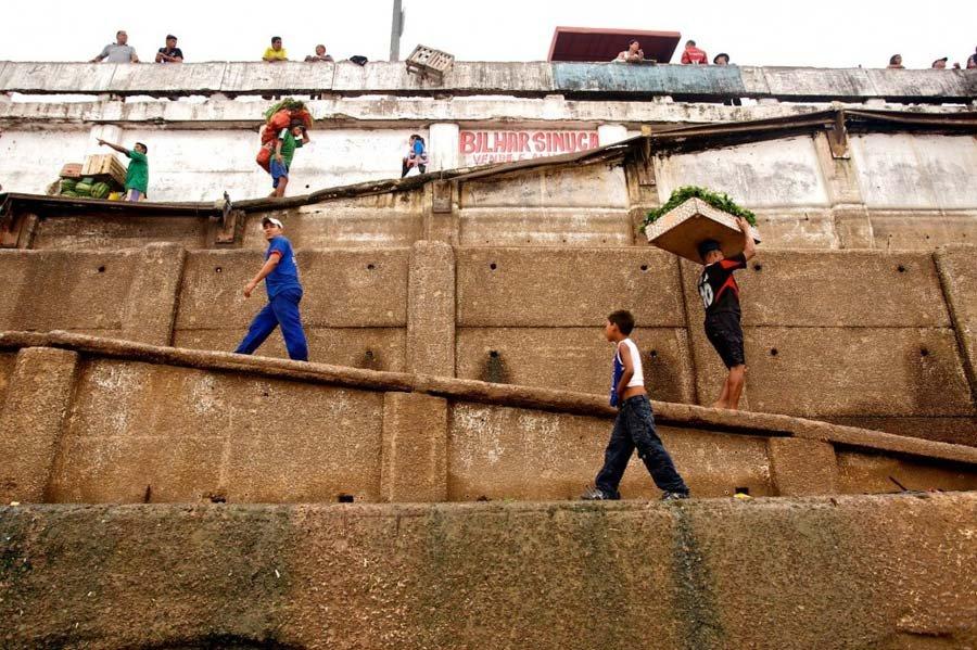 people walking on switchback concrete ramps