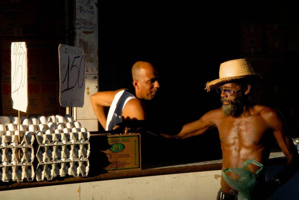 men talking at egg vendor