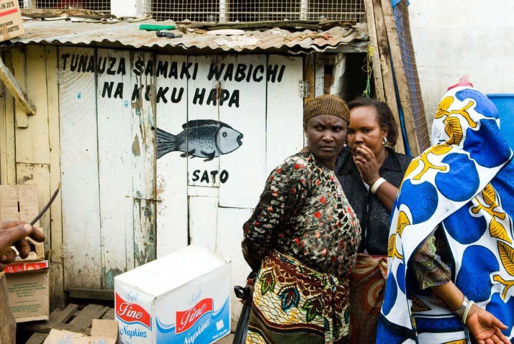 women talking in fish market