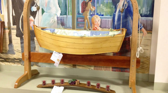 miniature wooden boat on display