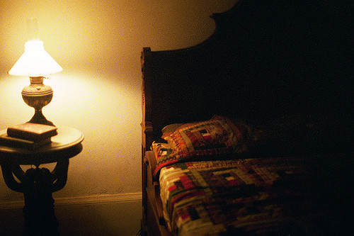 Lamp on bedside table, next to bed