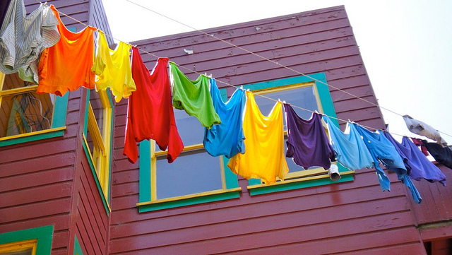 Colorful clothes hanging on clothing line