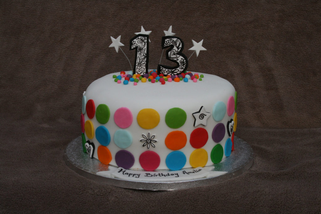 Colorful birthday cake with number 13 on top