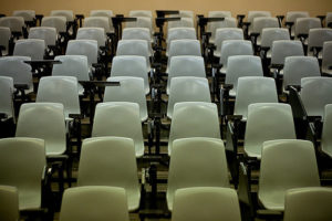 Rows of empty seats in a classroom