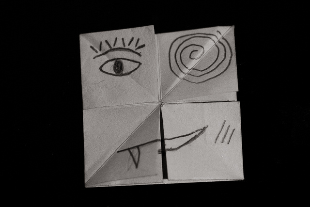 Face drawn on folded paper