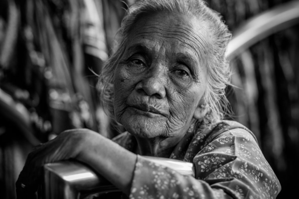 Black and white photo of an old woman