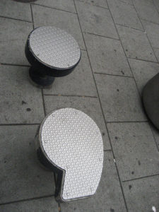 Stools in shape of semicolon