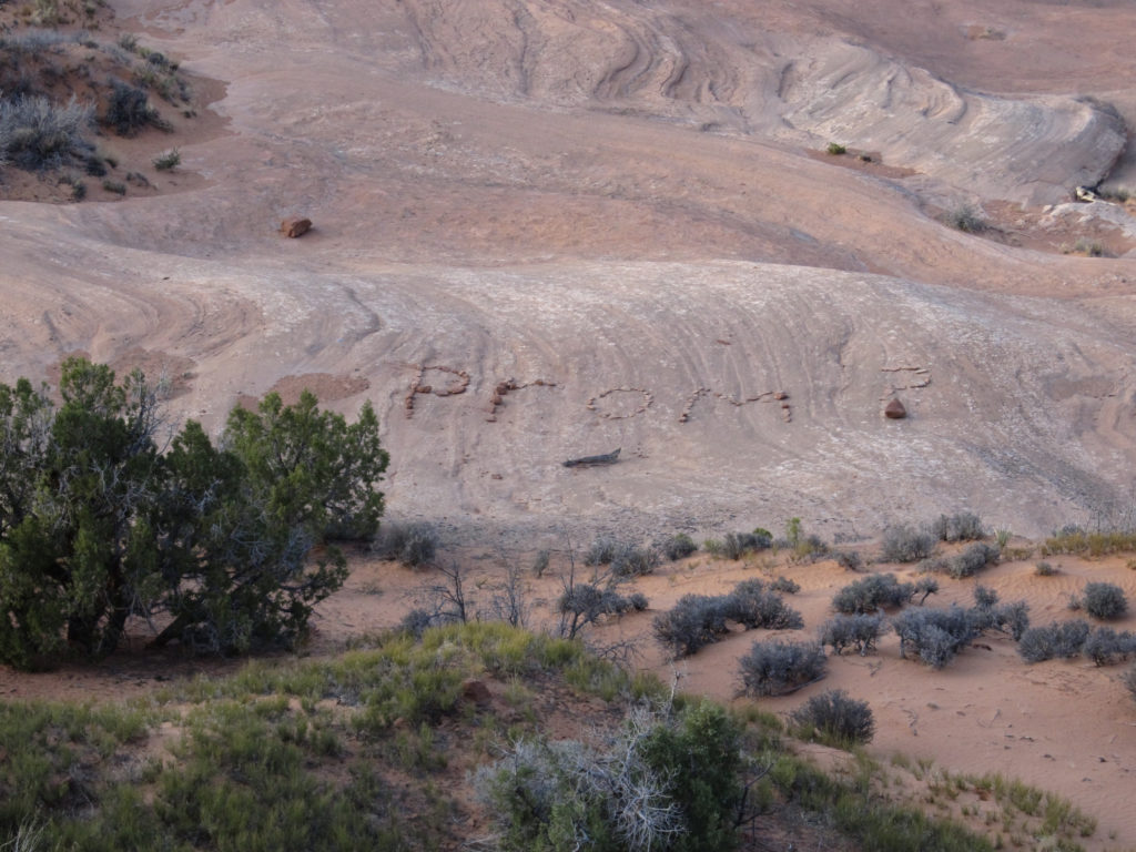 """Prom"" spelled out in rocks"