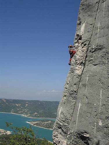 Person climing cliff