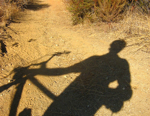 Shadow of person on bicycle