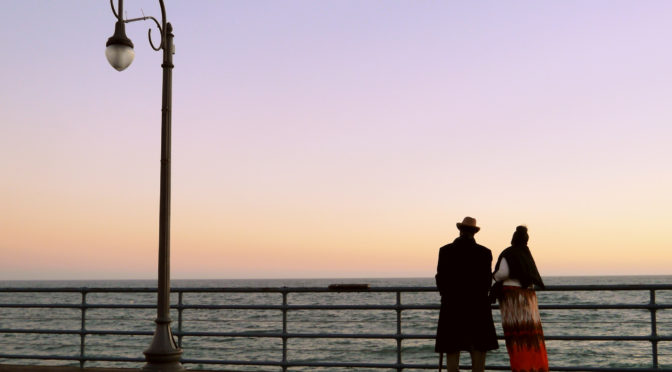 Two people looking out at the sea