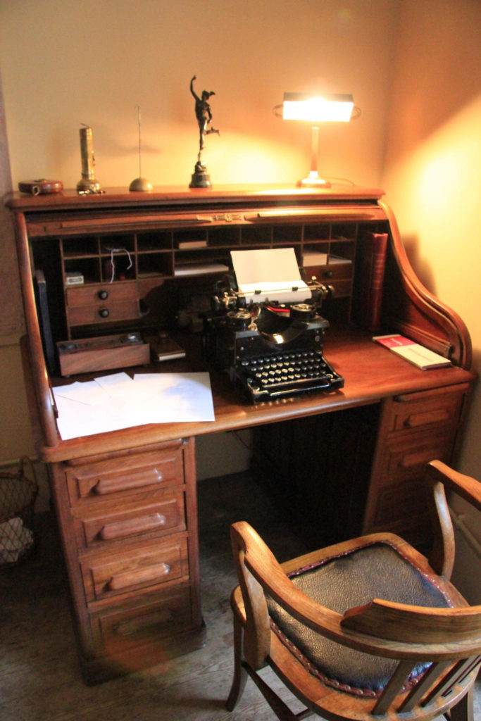 Desk with a typwriter on it