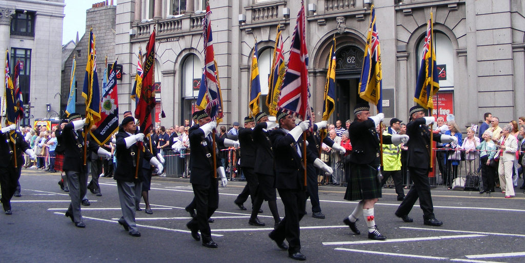 Veterans marching with large flags