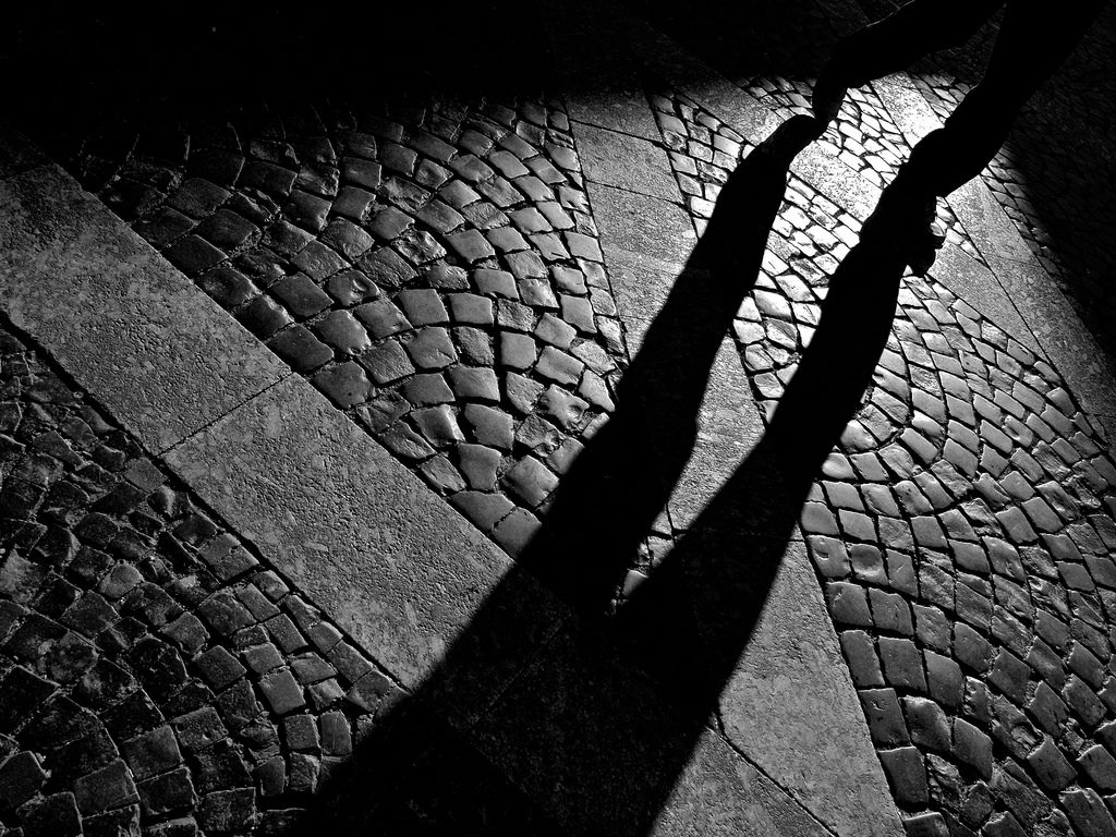 Shadow over cobblestones