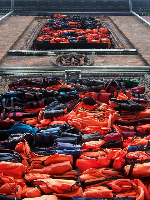 Many lifejackets together on side of building