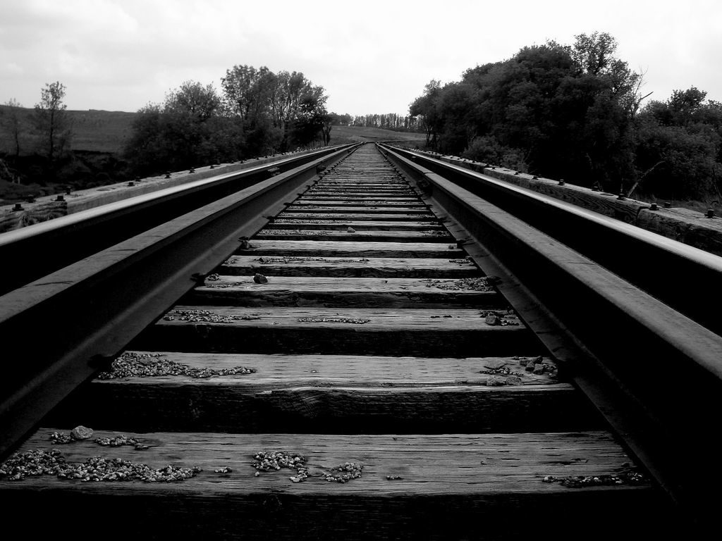 Black and white photo of railroad tracks