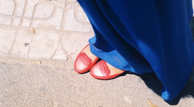 Red shoes under blue cloth
