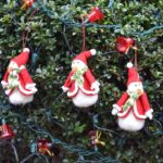 snowmen ornaments on hedge